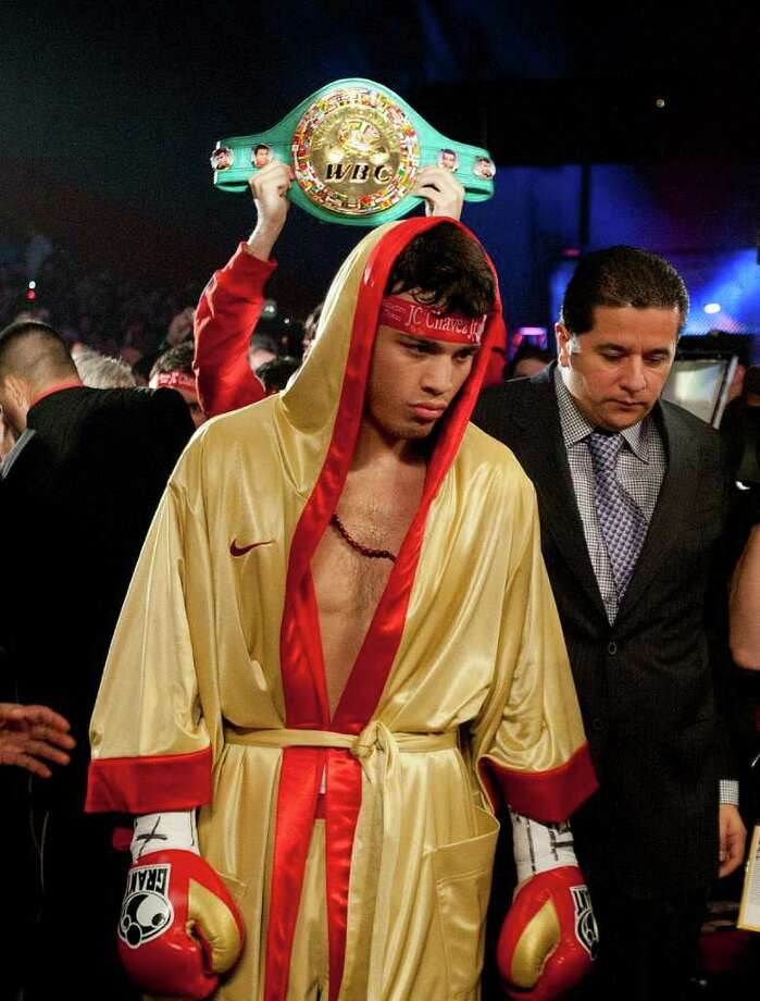 HOUSTON - NOVEMBER 19:  World Middleweight Champion Julio Chavez Jr. makes his way to the ring to defend his belt against Peter Manfredo Jr. at Reliant Arena at Reliant Park on November 19, 2011 in Houston, Texas. Photo: Bob Levey, Getty Images / 2011 Getty Images