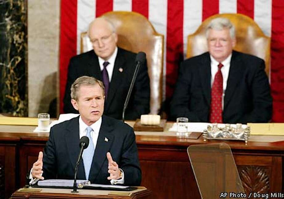 """President Bush gives his address on Capitol Hill Tuesday, Jan. 29, 2002. Vice President Dick Cheney, left, and House Speaker Dennis Hastert, R.-Ill. look on. Bush said Tuesday night that tens of thousands of terrorists still threaten America, """"ticking time bombs, set to go off,"""" and unveiled his plans to stalk them across the globe. He promised a battle of equal vigor to revive the ailing economy. (AP Photo/Doug Mills) Photo: DOUG MILLS"""