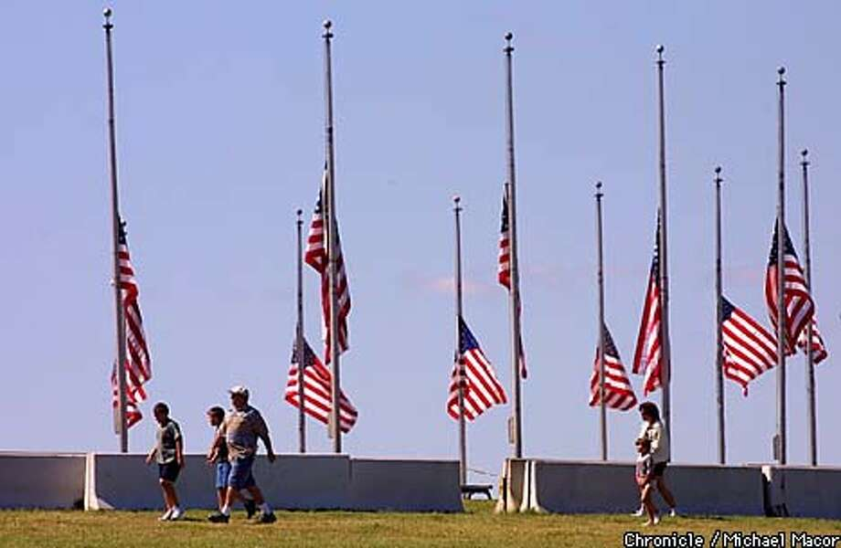 Flags that encircle the Washington Monumet all are lowered to half mast to honor those lost in the terrorist bombings earlieer this week. by Michael Macor/The Chronicle Photo: MICHAEL MACOR