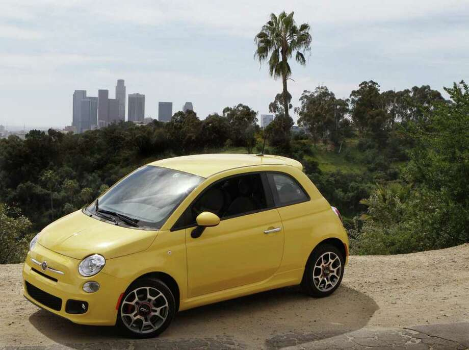 The 2012 Fiat 500 marks the Italian manufacturer's return to the U.S. market after a 28-year absence. Starting at $16,000, the two-door, four-seat subcompact comes in three versions and gets up to 38 mpg highway. Photo: Don Kelsen, Don Kelsen/Los Angeles Times / Los Angeles Times