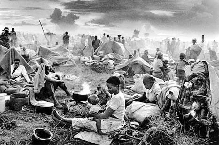 Sebasti�o Salgado, Refugee camp at Benako, Tanzania, 1994, gelatin silver print.� Copyright Sebasti�o Salgado / AMAZONAS / Contact Press Images  ONE TIME USE ONLY; FOR PRICING AND RIGHTS TO USE YOU MUST CONTACT: