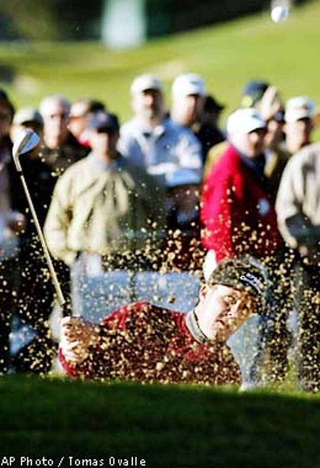 Phil Mickelson hits out of the bunker onto the green on the first hole during the second round of the National Pro-Am, Friday, Feb. 1, 2002, in , Calif. (AP Photo/The Fresno Bee, Tomas Ovalle) Photo: TOMAS OVALLE