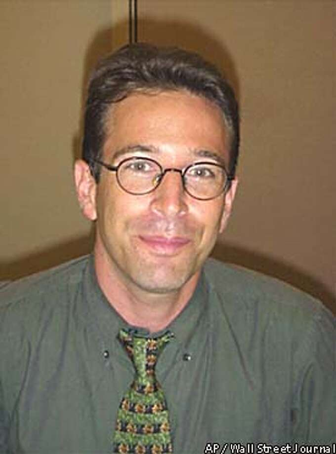 Daniel Pearl was shown with a gun pointing at his head in the latest photos. Wall Street Journal photo via Associated Press