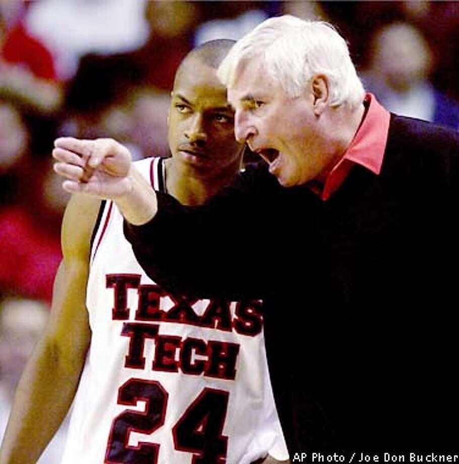 Texas Tech coach Bob Knight instructs Ronald Ross (24) during a break against Oklahoma State, Saturday, Jan. 19, 2002, in Lubbock, Texas. (AP Photo/Lubbock Avalanche-Journal, Joe Don Buckner) Photo: JOE DON BUCKNER