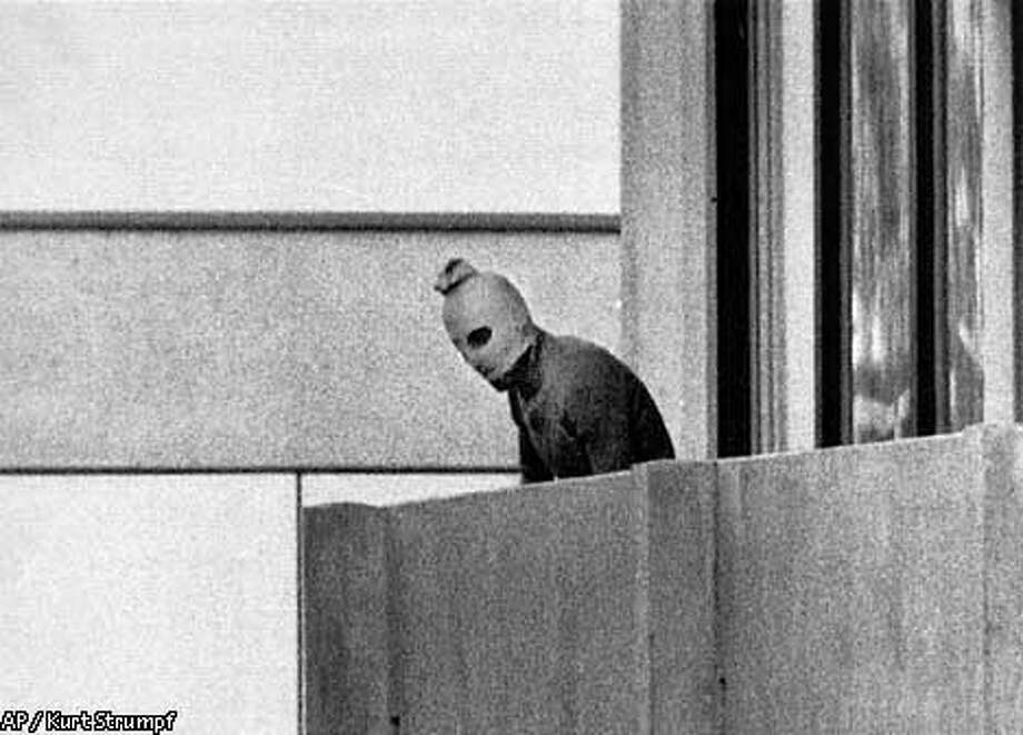 FILE--A member of the Arab Commando group which seized members of the Israeli Olympic Team at their quarters at the Munich Olympic Village in this Sept. 5, 1972 photo. Munich's frightening image of hooded terrorists holding Israeli athletes hostage. Atlanta's bomb in Centennial Park. Olympics are hardly strangers to violence and terrorism. Now, before a single snowflake falls in the mountains outside Salt Lake City, the threat of violence suddenly looms for the 2002 Winter Games. (AP Photo/Kurt Strumpf) Photo: KURT STRUMPF