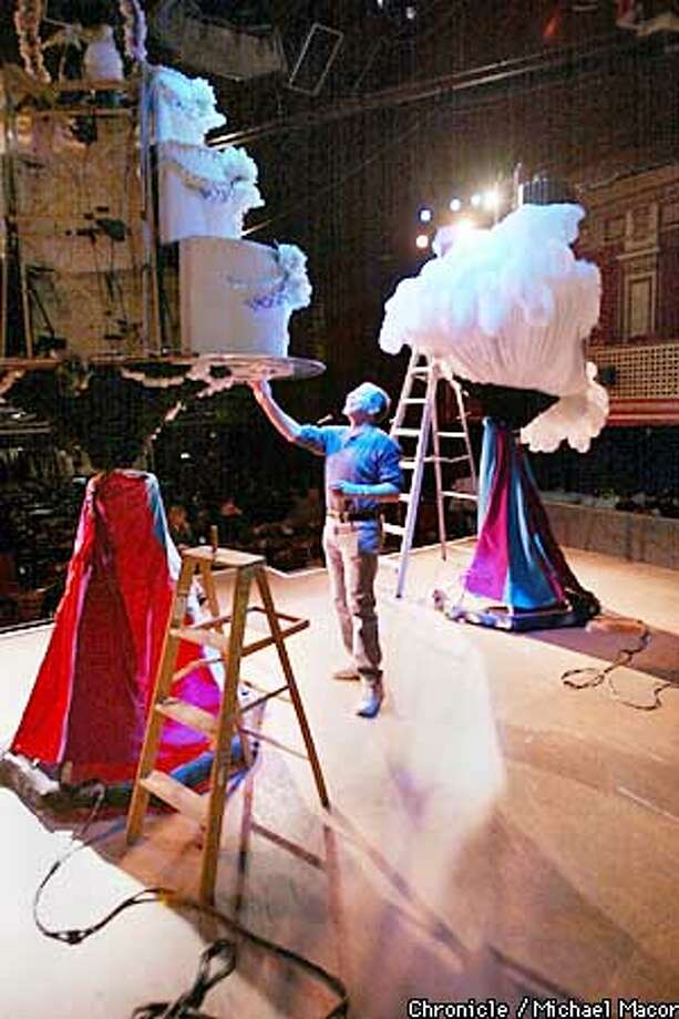 "Alan Greenspan, on the stage of "" Beach Blanket Babylon"", with the Wedding Cake Hat he designed along with the San Francisco Skyline. Profile on Alan Greenspan, who designs the gigantic hat fro the production of ""Beach Blanket Babylon"". At home he is an avid collector of Mad Hatter items from Alice in Wonderland, his house is full of it. by Michael Macor/The Chronicle Photo: MICHAEL MACOR"