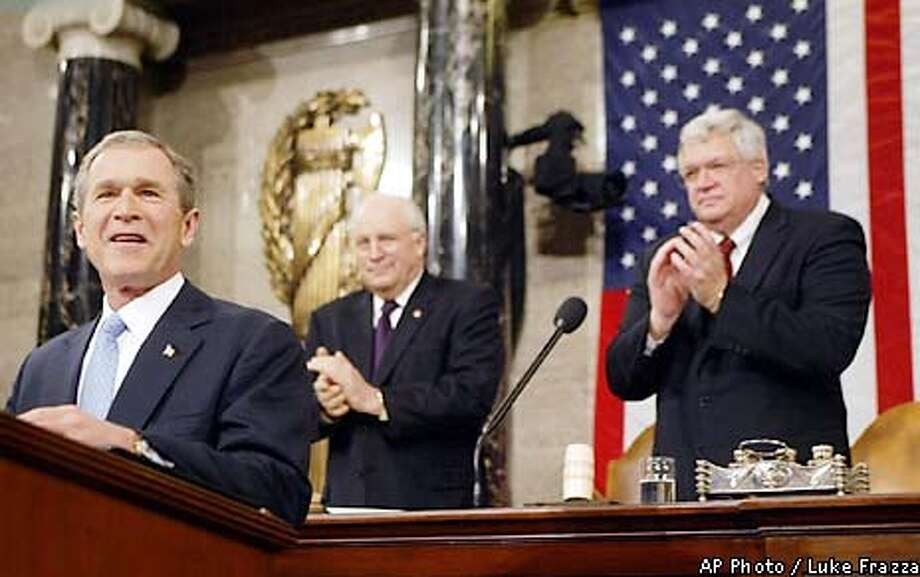 "President Bush, left, receives applause from Vice President Dick Cheney, second left, and House Speaker Dennis Hastert, R-Ill., right, in the House Chamber of the Capitol during Bush's address to a joint session of Congress, Tuesday, Jan. 29, 2002, in Washington. Bush opened by saying, ""As we gather tonight, our nation is at war, our economy is in recession, and the civilized world faces unprecedented dangers. Yet the state of our Union has never been stronger."" (AP Photo/Luke Frazza, Pool)) Photo: LUKE FRAZZA"