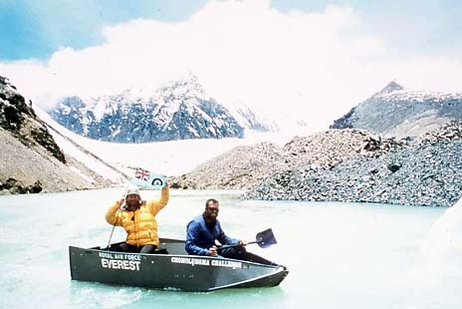 Two members of the RAF climbing team use snow shovel paddles and a Porta-Bote to cross a glacial lake at 20,000 feet on the Northeast ridge route of Mt. Everest in June 2001. Photo: HANDOUT