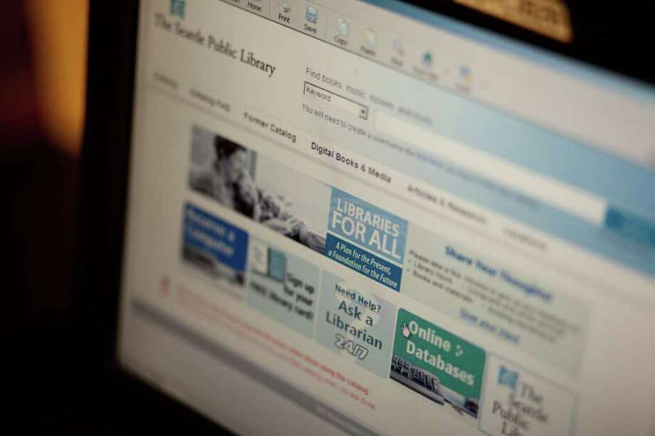 A computer is shown at the Lake City Branch of the Seattle Public Library on Tuesday, January 31, 2012. A patron recently complained after seeing a man openly viewing pornography on the computer. The librarian responded that it was not their responsibility to monitor the computers. Photo: JOSHUA TRUJILLO / SEATTLEPI.COM