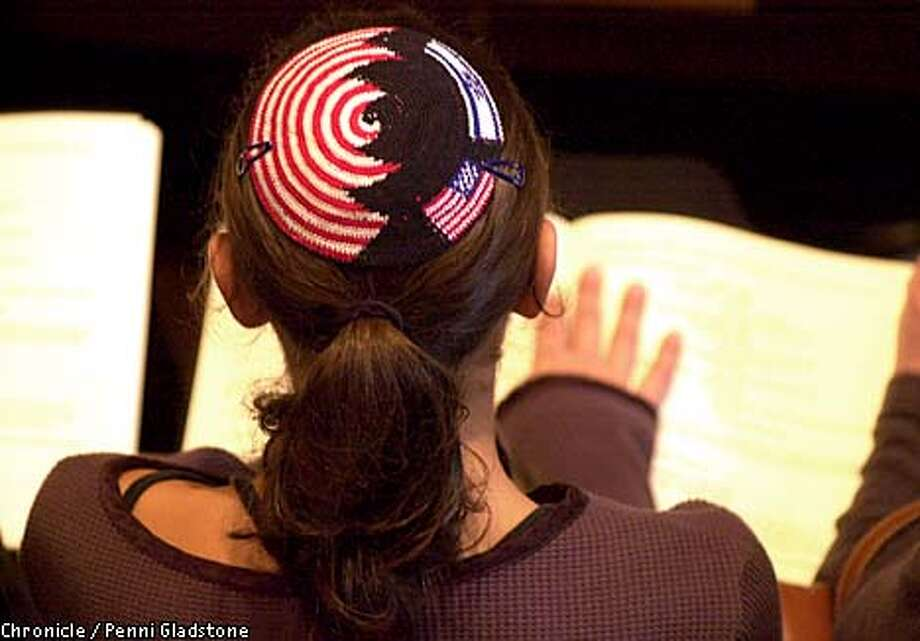 Religious service at Congregation Emanu-El in SF. A person wears a Yamulka with an American and Israeli flag on it as well as the red/white stripes at left and blue down the middle during the service. (only allowed to shoot from the back)  CHRONICLE PHOTO BY PENNI GLADSTONE Photo: Penni Gladstone