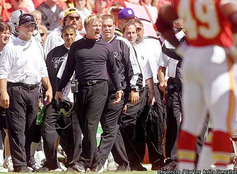 Oakland Raiders' head coach, John Gruden, expresses his disagreement with an official's call at Arrowhead Stadium in Kansas City, Mo., on Sunday, September 9, 2001. League officials are using replacement referees, creating soem discord with coaches, players, and fans. The Raiders won their first season game 27-24, on a Sebastian Janikowski field goal.  (Photo by Carlos Avila Gonzalez/The San Francisco Chronicle) Photo: CARLOS AVILA GONZALEZ