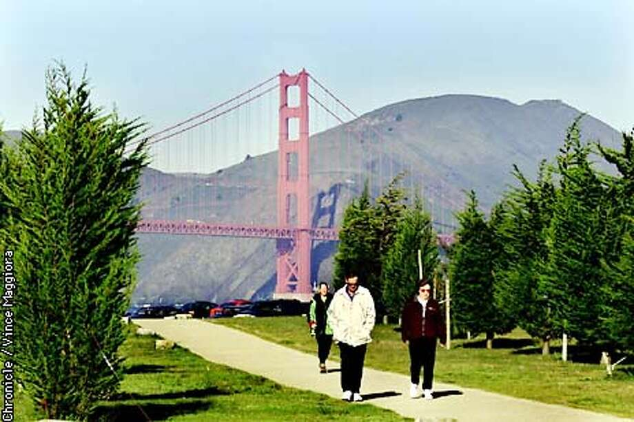 People out for a walk in the sun at Crissy Field before the rain start ,the forecast is for rain the next five days.  by Vince Maggioira Photo: VINCE MAGGIORA