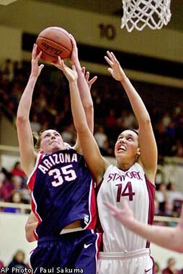 Arizona forward Krista Warren (35) grabs a rebound next tp Stanford forward Nicole Powell (14) in the first half Thursday, Jan. 24, 2002, in Stanford, Calif. (AP Photo/Paul Sakuma) Photo: PAUL SAKUMA