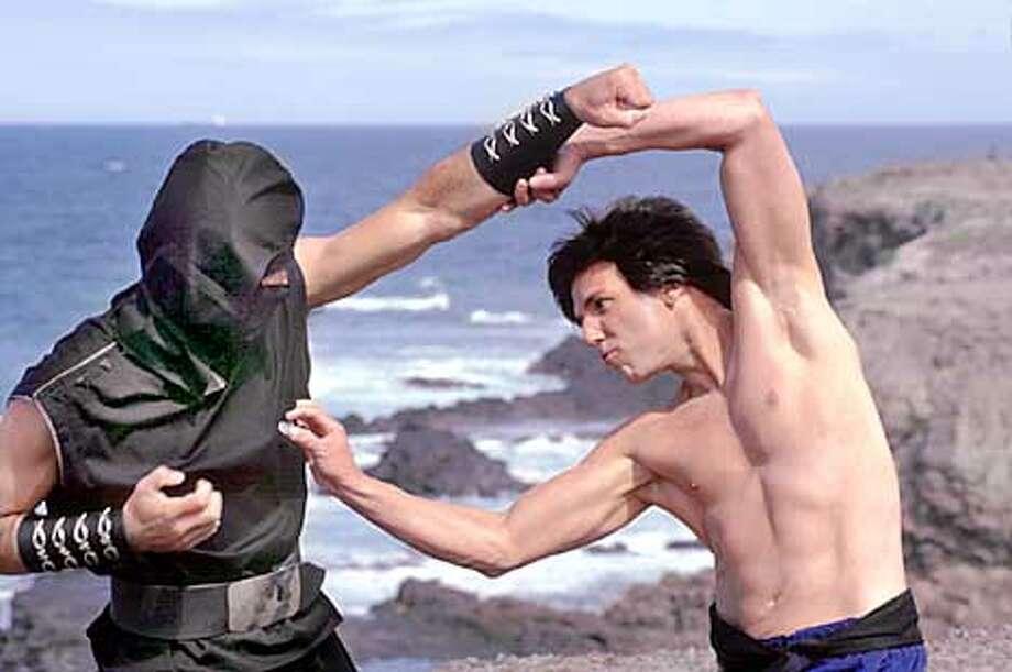 The Chosen One (STEVE OEDEKERK) battles a masked foe.
