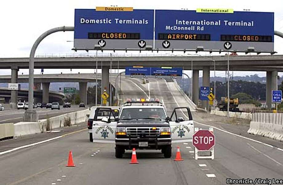 Security lockdown at San Francisco International Airport. No flights are allowed out due to three planes bombing and hitting the World Trade Center buildings in New York City and the Pentagon on September 11, 2001. Photo of the road block to SFO along Highway 101. Photo by Craig Lee/San Francisco Chronicle Photo: CRAIG LEE