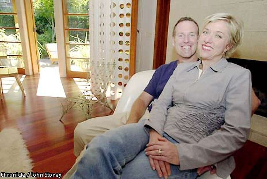 ATHOME12-C-27AUG01-HM-JRS-Lara Deam and her husband Christopher Deam at their home in Mill Valley with their dog, Koa. Chronicle photo by John Storey. Photo: John Storey