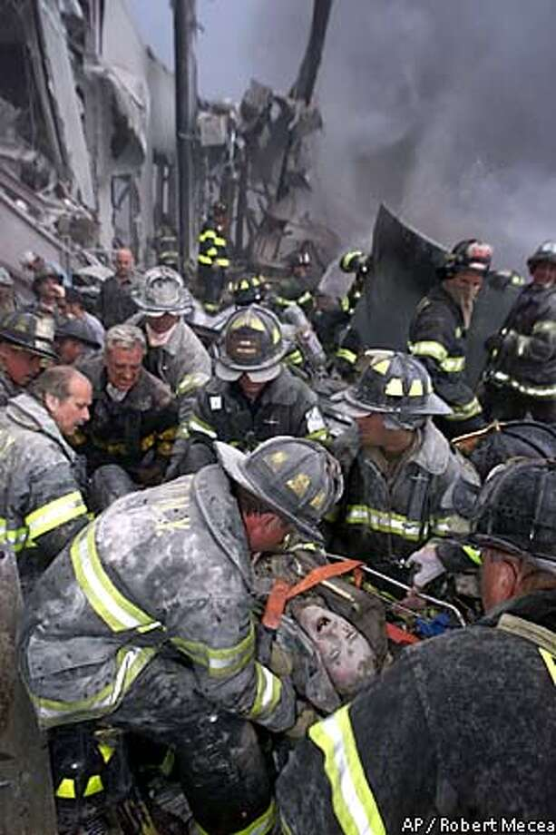 EDS NOTE: IMAGE NYANE501 IS FROM TUESDAY, SEPT. 11, 2001--A fireman screams in pain during his rescue shortly after both towers of New York's World Trade Center collapsed following a terrorist attack, Tuesday, Sept. 11, 2001. (AP Photo/Robert Mecea, Newsday) MAGAZINES OUT, , NO ONLINE, MANDATORY CREDIT. Photo: ROBERT MECEA