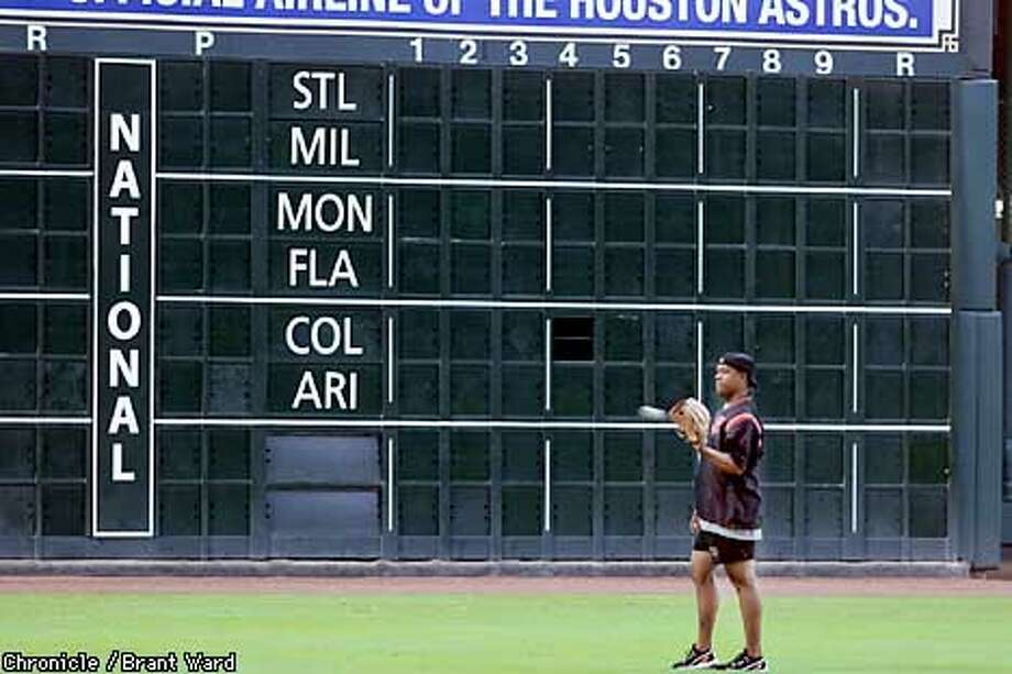Giants pitcher Livan Hernandez played catch next to an empty National League scoreboard Wednesday as the Giants worked out at Enron Field in Houston. Their entire series with the Astros has been cancelled. By Brant Ward/Chronicle Photo: BRANT WARD