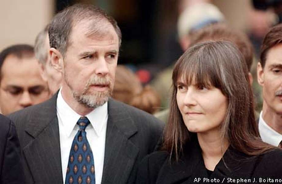 Frank Lindh and Marilyn Walker, divorced parents of captured fighter John Walker Lindh attend a news conference outside Alexandria federal court where their son was arraigned on charges that he conspired to kill his fellow Americans in Afghanistan, on Thursday, Jan. 24, 2002 in Alexandria, Va.(AP Photo/Stephen J. Boitano) Photo: STEPHEN J. BOITANO