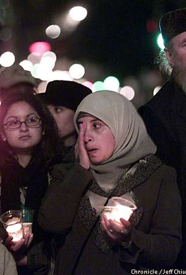 Iman Farajallah, a Palestinian living in the bay area, wipes a tear from her eye while attending a Muslim rally in San Francisco on Wednesday evening. Farajallah is a Palestinian who has family in Israel. Photo by Jeff Chiu / The Chronicle. Photo: Jeff Chiu