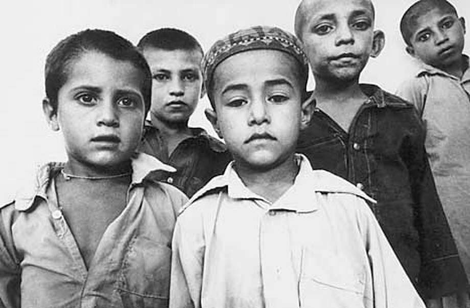 Orphan Afghan Boys - Orphan Afghan boys in a Pakistani run religiousschool for boys, Madrassa. Peshawar, Pakistan. 1984