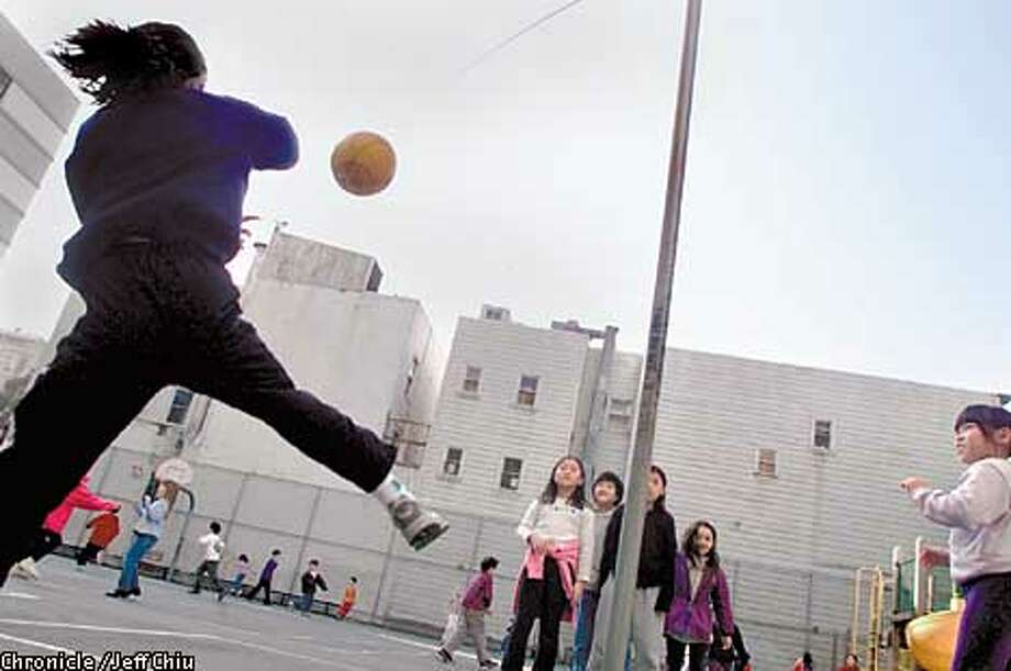 "8-year-old Ying Ying Fry, at left, hits the tetherball during recess at Chinese American International School and at home in San Francisco on Thursday afternoon. Fry, who had written the book ""Kids Like Me in China"" about herself and other young kids up for adoption in China in 2001, is also involved with athletics, playing soccer and in a running program. Photo by Jeff Chiu / The Chronicle. Photo: Jeff Chiu"