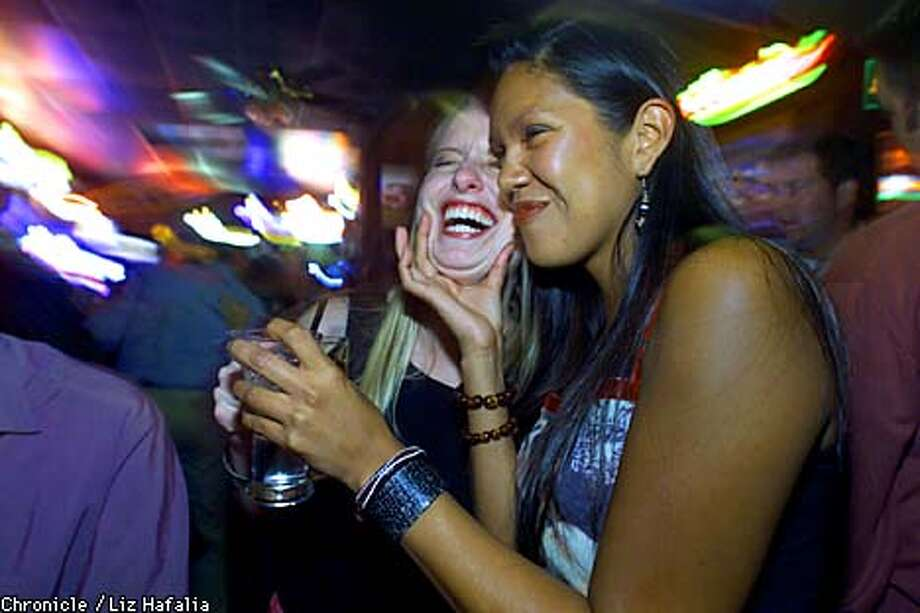 JenniferO'Donnell (middle) and her friend Tyra Hendershot (right) kidding around at a North Beach bar.  (BY LIZ HAFALIA/THE SAN FRANCISCO CHRONICLE) Photo: LIZ HAFALIA