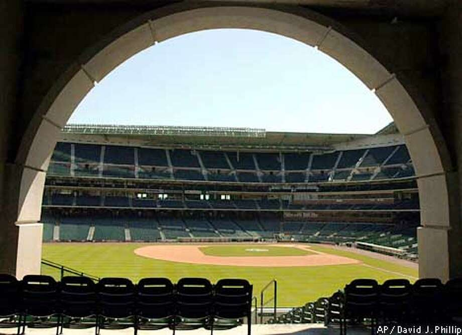 Enron Field, home of the Houston Astros, sits empty Tuesday, Sept. 11, 2001 in Houston. Major league baseball postponed its entire schedule of 15 games Tuesday night, including a scheduled game between the Astros and San Francisco Giants, following terrorist attacks in New York and Washington. (AP Photo/David J. Phillip) Photo: DAVID J. PHILLIP