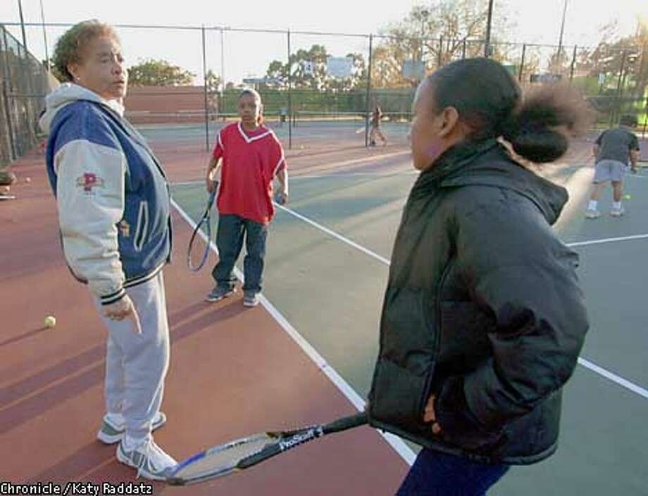 Photo by Katy Raddatz--The Chronicle  Barbara Lewis runs an after-school tennis program at Nicholl Park in Richmond. SHOWN: Barbara Lewis talks to Yeong MacMorris, age 11, while she's waiting to play. Photo: KATY RADDATZ