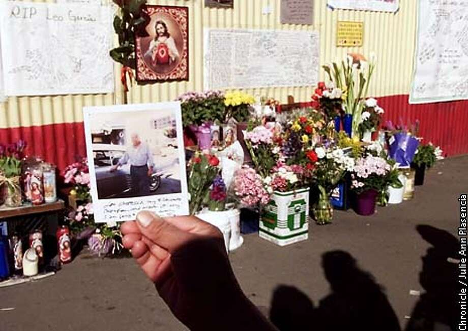 Ruth Alvarez, a cousin to Leo Garcia who was killed by a semi that went out of control in the Mission district, holds a photographed of the deceased in front of a memorial placed on the wall blocks from where Garcia was killed and where the he worked as a mechanic for over 30 years  (JULIE PLASENCIA/SFC) Photo: JULIE PLASENCIA