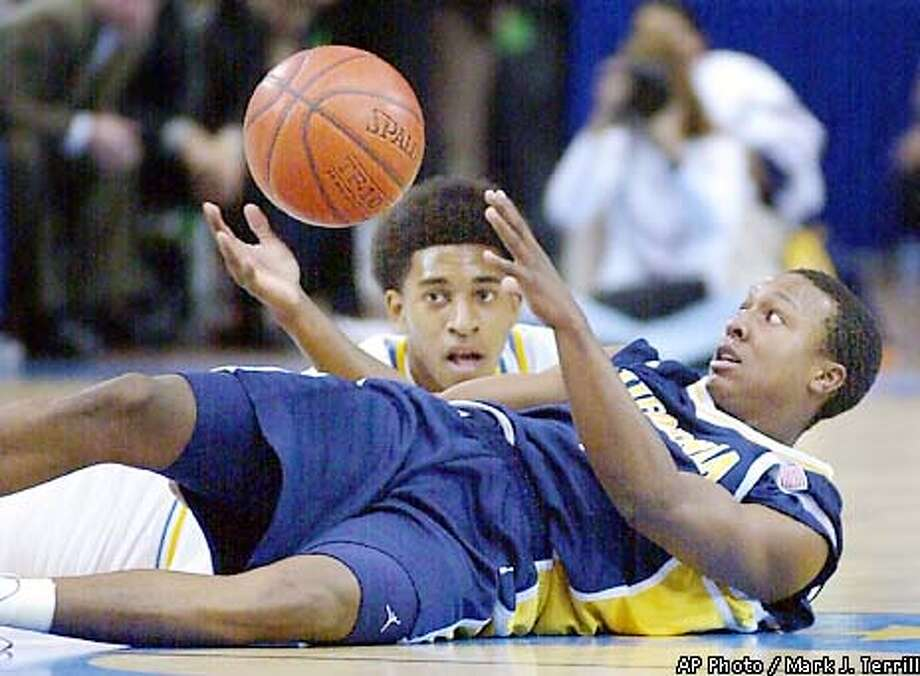 California's A.J. Diggs, right, goes after a loose ball with UCLA's Bedric Boseman in the first half Saturday, Jan. 26, 2002, in Los Angeles. (AP Photo/Mark J. Terrill) Photo: MARK J. TERRILL