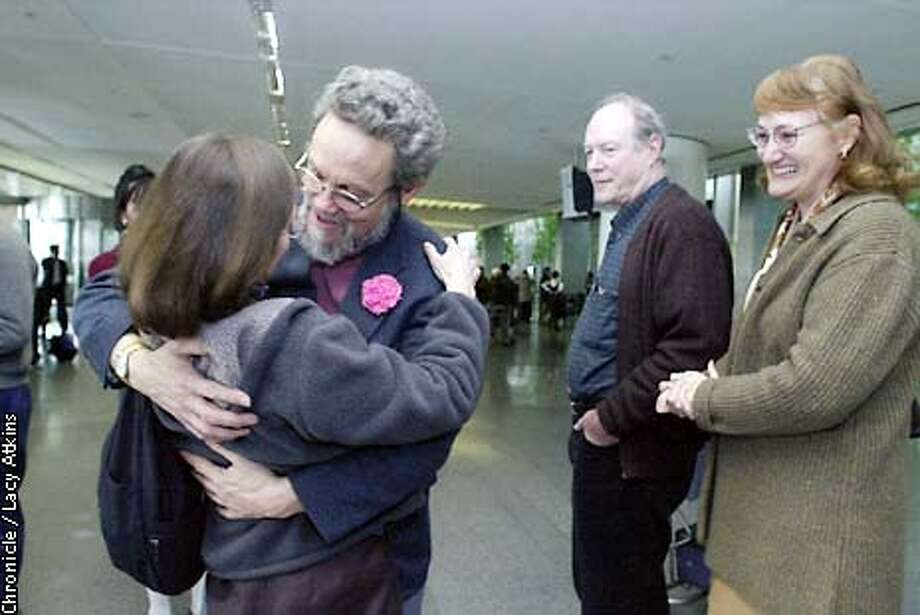 Derrill Bodley is greeted with a huge by his wife Nancy and brother Walt and sister- inlaw, Sandra, at the International Terminal at SFO, Tuesday JAn.22,02. Derrill was coming back from Afghanistan after visiting with other family members of victims of Sept.11 attack. His daughter Deora was on flight 93. CHRONICLE PHOTOGRAPHER/ LACY ATKINS Photo: Lacy Atkins