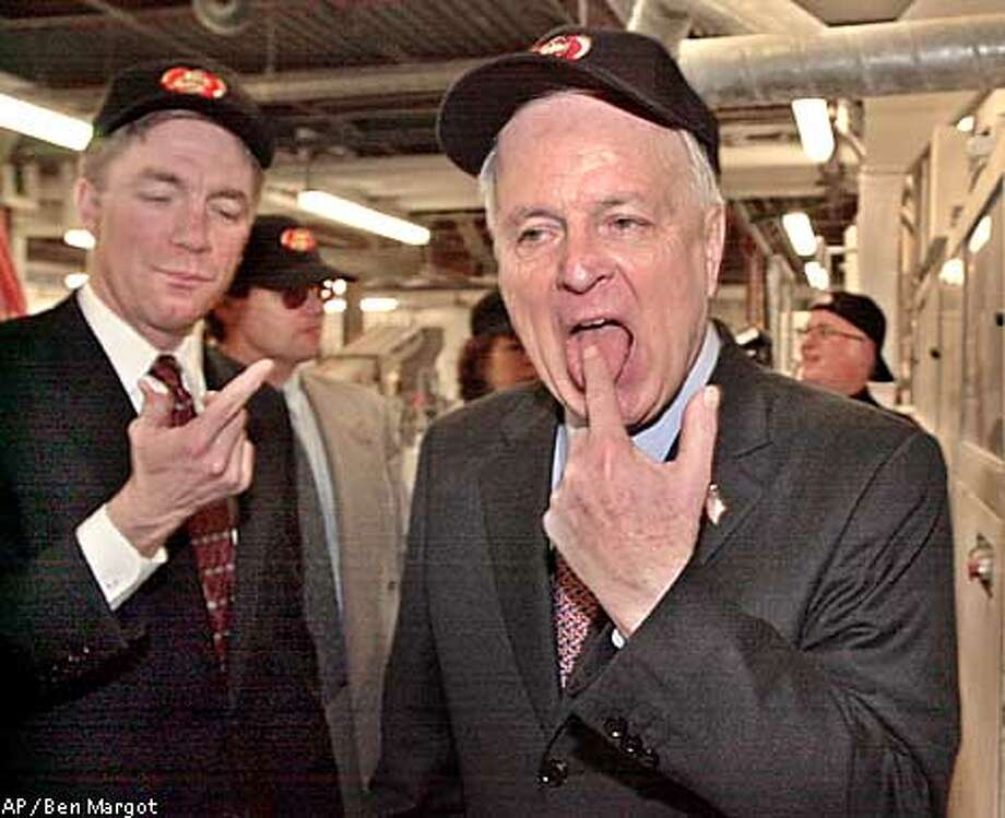 """Republican gubernatorial candidate Richard Riordan, right, and Rep. Doug Ose, R-Sacramento, sample sugar that is used to manufacture """"Jelly Belly"""" jellybeans Monday, Jan. 28, 2002, at the Jelly Belly Candy Company in Fairfield, Calif. (AP Photo/Ben Margot) Photo: BEN MARGOT"""