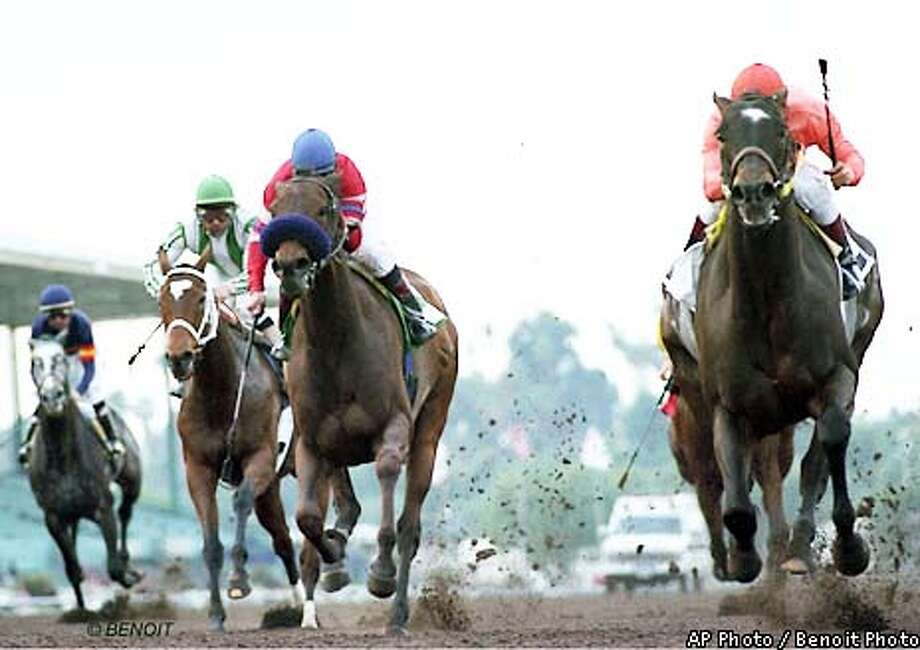 Kalookan Queen, right, with Alex Solis aboard, holds off longshot Leading Light, second from right, ridden by Patrick Valenzuela, and Spain, second from left, ridden by Victor Espinoza, to win the $200,000 Santa Monica Handicap, Saturday, Jan. 26, 2002, at Park in Arcadia, Calif (AP Photo/Benoit Photo) Photo: BENOIT PHOTO