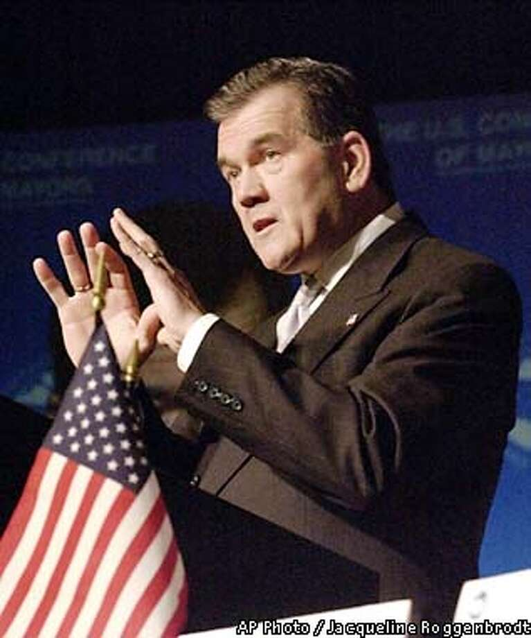 Homeland Security Chief Tom Ridge addresses the U.S. Conference of Mayors in Washington Wednesday, Jan. 23, 2002. Ridge told the mayors they will get more federal help to offset their rising costs in the wake of the war on terrorism. (AP Photo/Jacqueline Roggenbrodt) Photo: JACQUELINE ROGGENBRODT