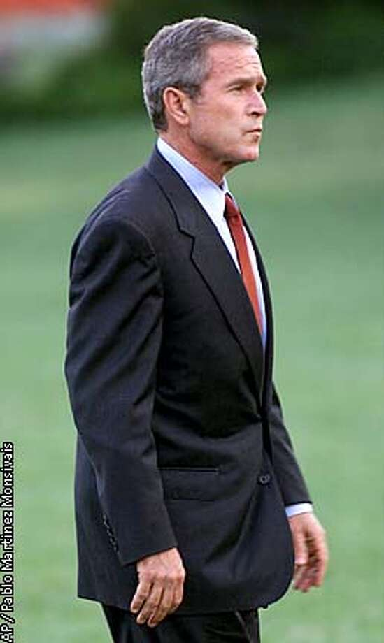President Bush walks to the Oval Office during his arrival on the South Lawn of the White House Tuesday, Sept. 11, 2001 in Washington. Bush returned to Washington to address the nation. (AP Photo/Pablo Martinez Monsivais) Photo: PABLO MARTINEZ MONSIVAIS