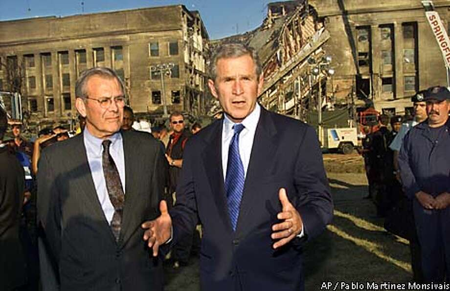 President Bush examines the devastation at the Pentagon, Wednesday, Sept. 12, 2001. Accompanied by Secretary of Defense Donald Rumsfeld, left, Bush thanked rescue workers for their efforts as he stood in front of the damage created by the highjacked airliner that slammed into the building on Tuesday. (AP Photo/Pablo Martinez Monsivais) Photo: PABLO MARTINEZ MONSIVAIS