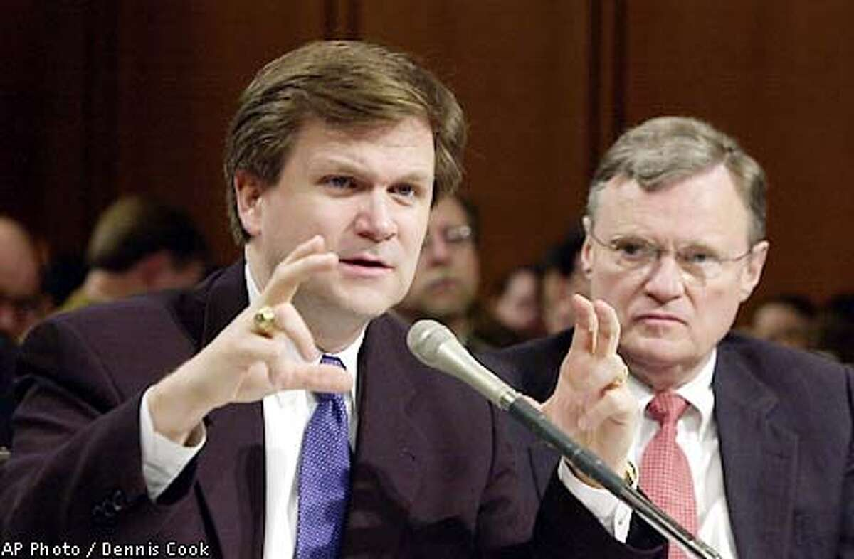 Federal Energy Energy Regulatory Commission Chairman Patrick Wood appears before the Senate Energy and Natural Resources Committee on Capitol Hill Tuesday, Jan. 29, 2001, to discuss the impact of the collapse of Enron. At right is William Nugent, president of the National Association of Regulatory and Utility Commissioners. (AP Photo/Dennis Cook)
