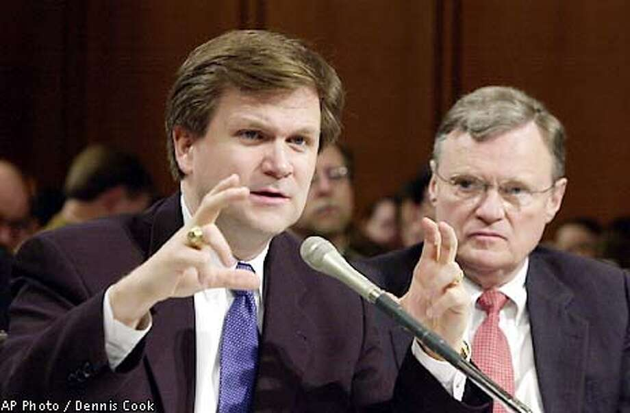 Federal Energy Energy Regulatory Commission Chairman Patrick Wood appears before the Senate Energy and Natural Resources Committee on Capitol Hill Tuesday, Jan. 29, 2001, to discuss the impact of the collapse of Enron. At right is William Nugent, president of the National Association of Regulatory and Utility Commissioners. (AP Photo/Dennis Cook) Photo: DENNIS COOK