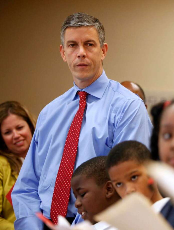 "FILE - In this Sept. 29, 2009, U.S. Education Secretary Arne Duncan listens to fourth graders read at Delaplaine McDaniel Elementary School in Philadelphia,   as part a ""listening and learning"" tour to find out what school strategies are working and why. Duncan welcomes the Gates Foundation's involvement in education reform. ""The more all of us are in the game of reform, the more all of us are pushing for dramatic improvement, the better,"" Duncan said in an interview with The Associated Press.  (AP Photo/Matt Rourke, FILE) Photo: Matt Rourke, AP / AP"