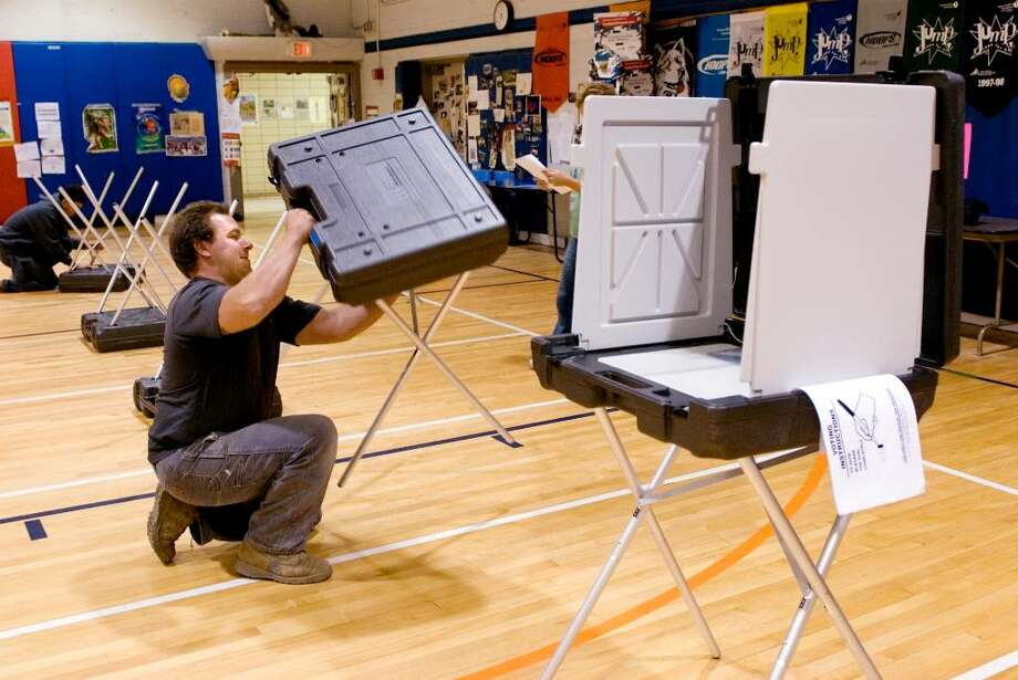 Greg Bivona and his nephew Joe Bovona set up voting booths at Stark Elementary School in Stamford,Conn on Monday November 2,2009 for tomorrows election. Photo: Dru Nadler / Stamford Advocate