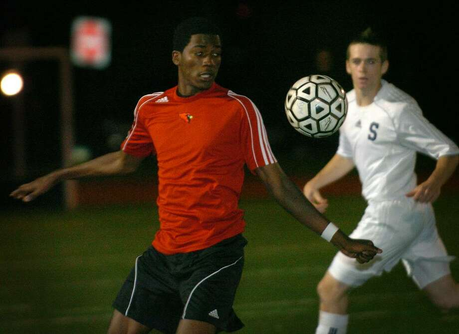 Greenwich's Kenny Doublette plays a ball in the offensive end during Monday's FCIAC semi-final game against Staples at Ludlowe High School in Fairfield. Greenwich lost the game 1-0. Photo: Brian A. Pounds / Connecticut Post