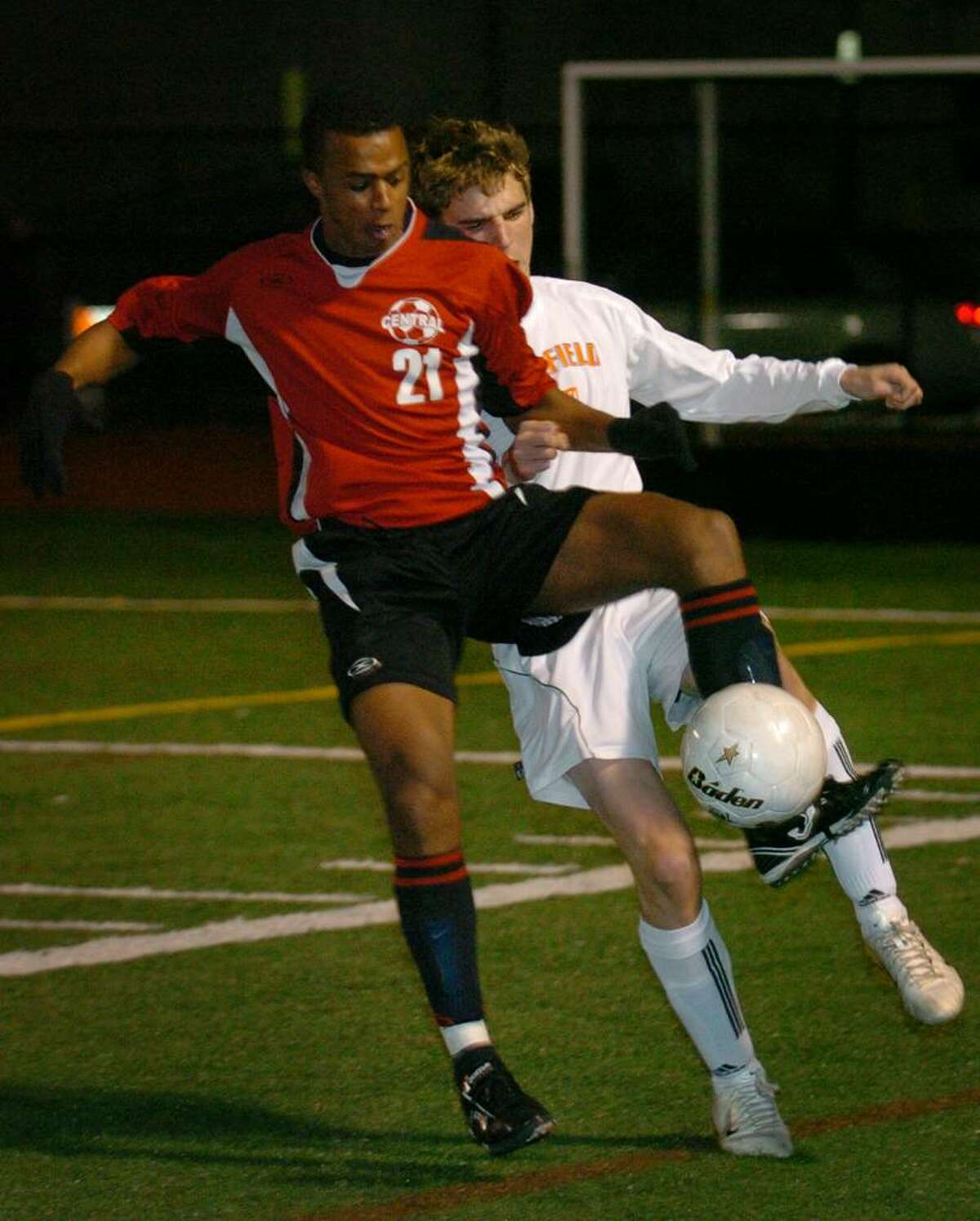Bridgeport Central's Antonio DaGraca plays the ball in front of Ridgefield defender Colin Paulish during Monday's FCIAC semi-final matchup at Ludlowe High School in Fairfield.