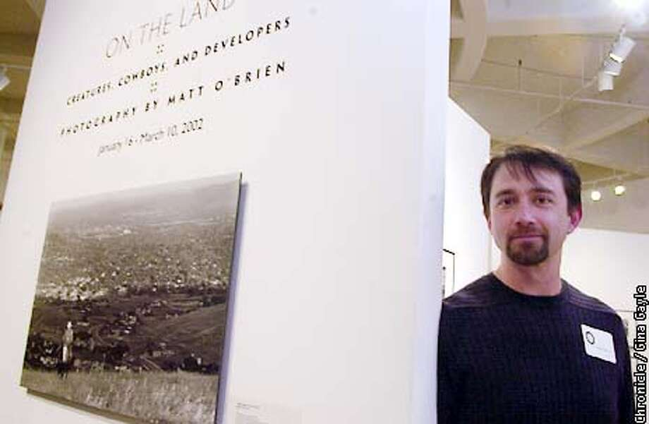 """Photographer Matt O'Brien stands near his body of work at the opening reception for """"On the Land: Creatures, Cowboys and Developers"""" which is being shown at the Bedford Art Gallery in Walnut Creek. Photo by Gina Gayle/The SF Chronicle. Photo: GINA GAYLE"""