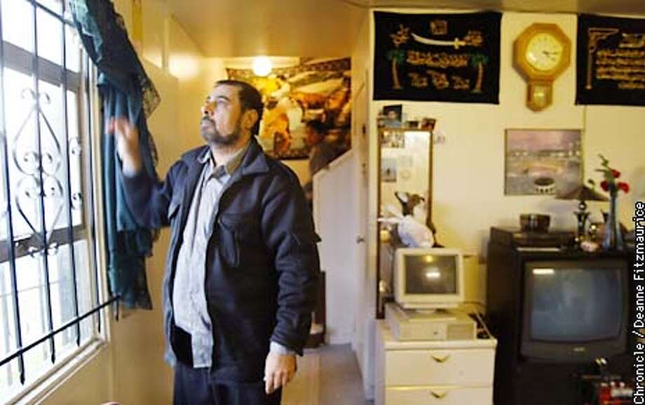 Jawad Al-Gazawi looks out the bars of his living room window. He lives in the Alice Griffiths projects in San Francisco and he and his family have been victims of hate crimes since Sept. 11.  CHRONICLE PHOTO BY DEANNE FITZMAURICE Photo: DEANNE FITZMAURICE