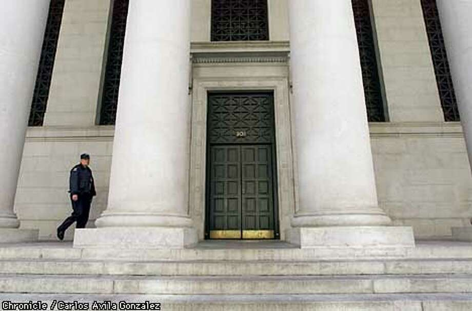 A security guard keeps watch at the Pacific Stock Exchange in San Francisco, Ca., on Tuesday, September 11, 2001, the same morning of the worst terrorist attack in U.S. history in New York, and Washington, D.C. Nearly all financial institutions in the San Francisco financial district were closed along with state and federal buildings.  (Photo by Carlos Avila Gonzalez/The San Francisco Chronicle) Photo: CARLOS AVILA GONZALEZ