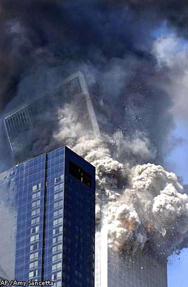 The south tower of the World Trade Center begins to collapse following a terrorist attack on the New York landmark Tuesday, Sept. 11, 2001. (AP Photo/Amy Sancetta) Photo: AMY SANCETTA