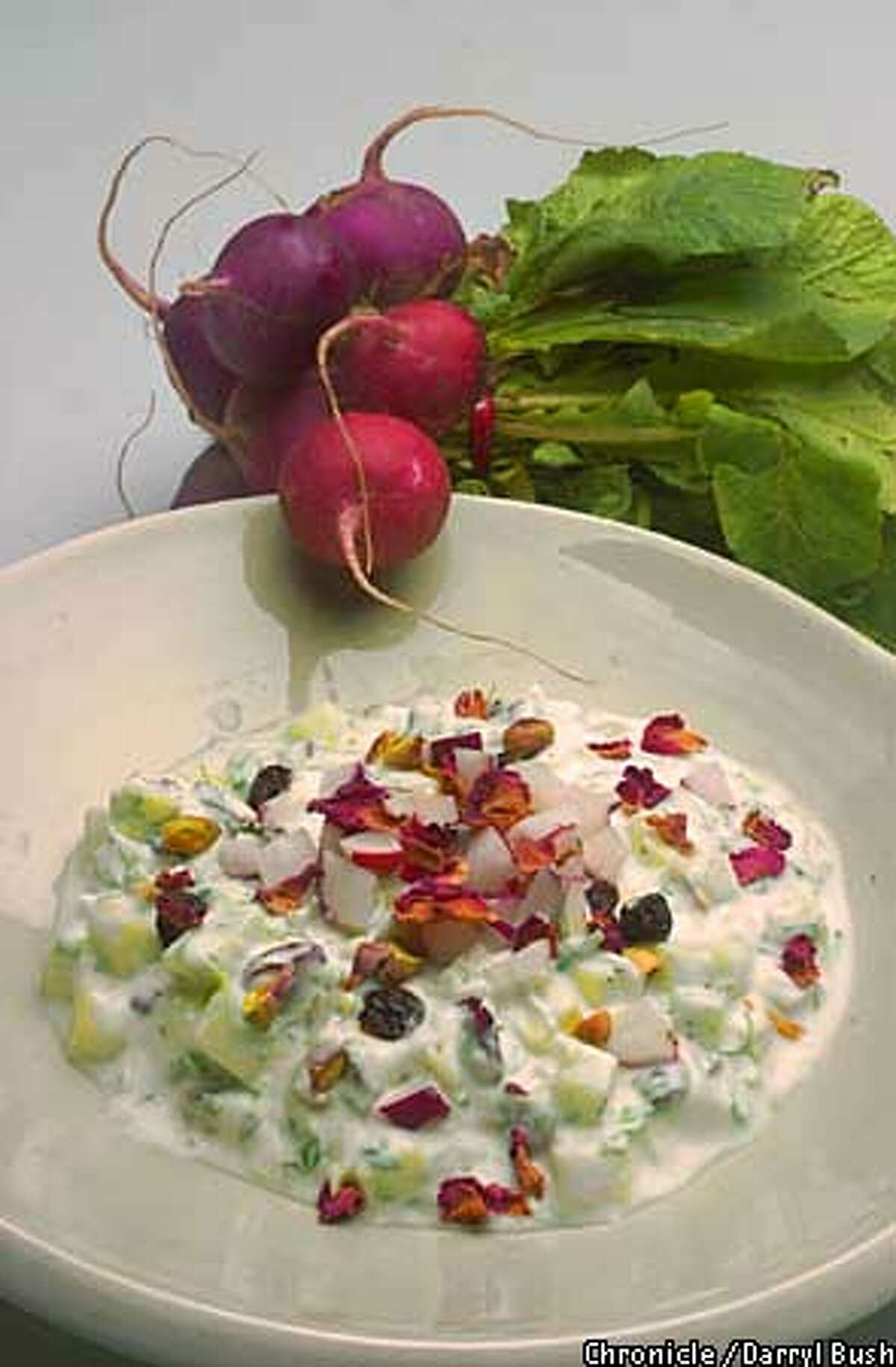 Yogurt and cucumber salad with rose petals dish. Chronicle Photo by Darryl Bush Food Styling by Noel Advincula