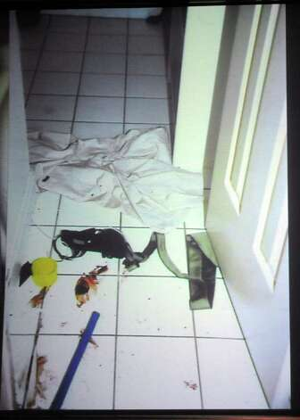 Photographs of the scene of Anna Lisa Raymundo's murder in 2002 are shown on a screen during the trial of her alleged murderer, Sheila Davalloo, in State Superior Court in Stamford on Tuesday, January 31, 2012. Photo: Lindsay Niegelberg / Stamford Advocate
