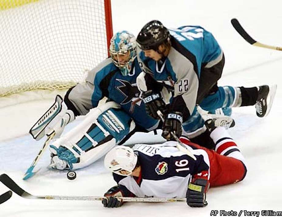 San Jose Sharks goalie Evgeni Nabokov of Russia blocks a shot by Columbus Blue Jackets' Mike Sillinger (16) as Sharks' Scott Hannan (22) assists in the second period Thursday, Jan. 24, 2002, in Columbus, Ohio. (AP Photo/Terry Gilliam) Photo: TERRY GILLIAM